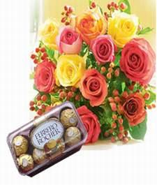 Box of Fererro Rocher (16 pieces) and a Bouquet of Flowers