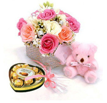 12 Pink Roses in a Vase with  Teddy and heart shaped chocolates